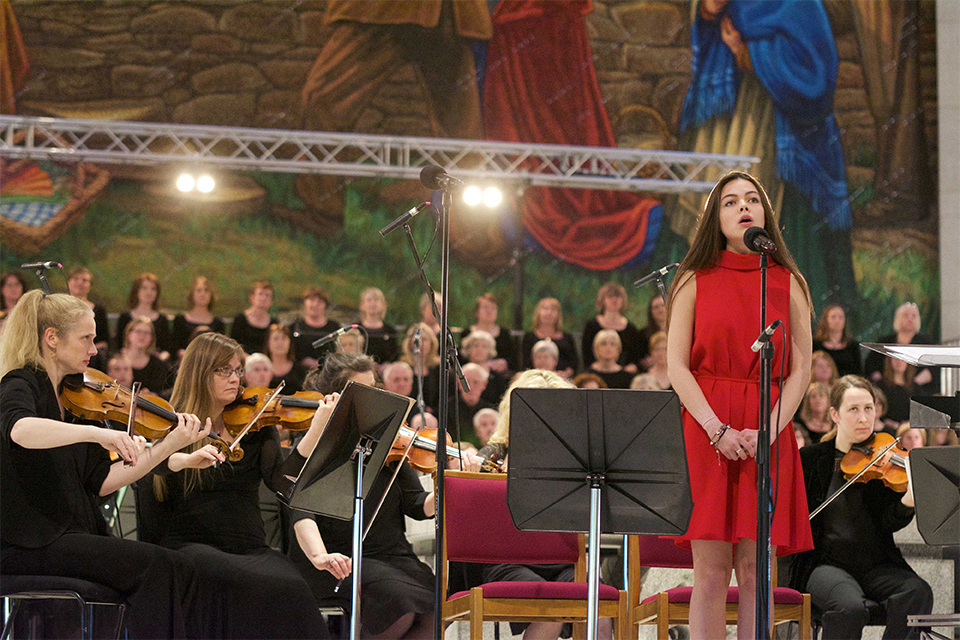 Sibéal Ní Chasaide singing Mise Éire with the RTÉ Concert Orchestra at the Concert For Peace in Knock Basilica, presented by the Mayo International Choral Festival in association with the Western Development Commission. The event also featured the 120-strong Peace Choir, which can be seen in the background. Photo: Alison Laredo