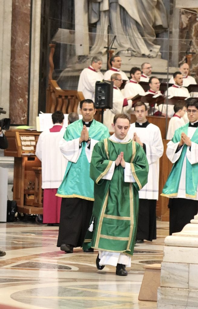 Seminarian Shane Costello leads the entrance procession
