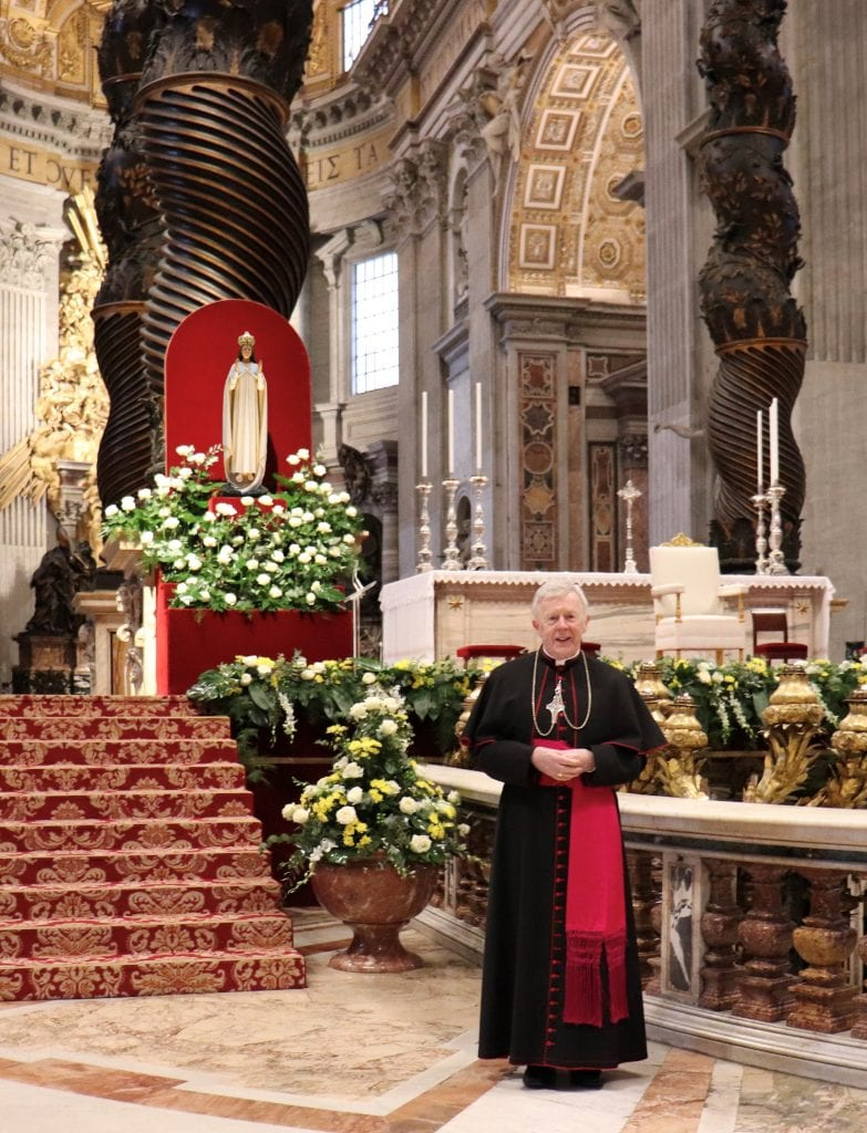 Archbishop Michael Neary in St Peters Basilica with Statue of Our Lady of Knock
